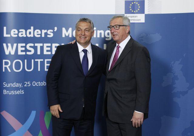Maďarský premiér Viktor Orbán (vlevo) a prezident EK Jean-Claude Juncker na bruselské schůzce k migrační krizi. (ČTK)