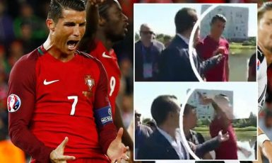 PAY-Cristiano-Ronaldo-throws-a-journalists-microphone-into-a-lake