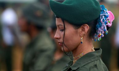 A fighter from Revolutionary Armed Forces of Colombia (FARC) stands in line during the opening of ceremony congress at the camp where they prepare for ratifying a peace deal with the government, near El Diamante in Yari Plains, Colombia, September 17, 2016.  REUTERS /John Vizcaino ()
