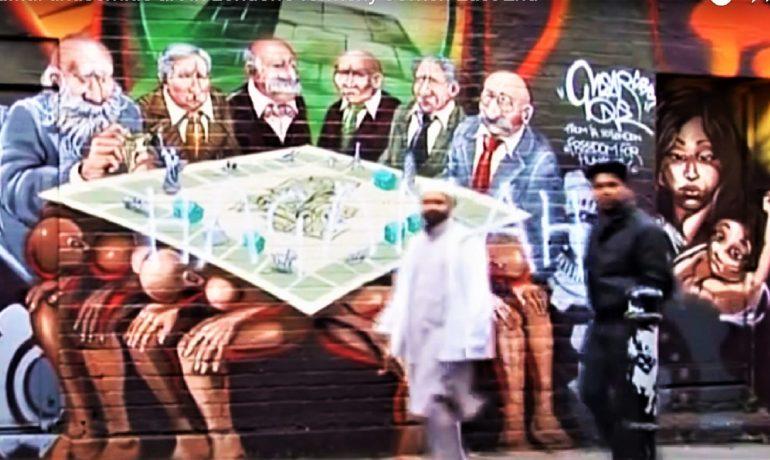 Antisemitský výtvor na jedné z londýnských ulic.  Tajné židovské spiknutí řídí svět. (youtube)