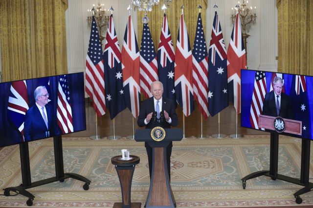 President Joe Biden delivers remarks about a national security initiative on September 15, 2021 in the East Room of the White House in Washington, DC. President Biden is joined virtually by Prime Minister Scott Morrison of Australia and Prime Minister Boris Johnson of the United Kingdom (Photo by Oliver Contreras/Pool/ABACAPRESS.COM) ()